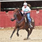 Girl racing a horse